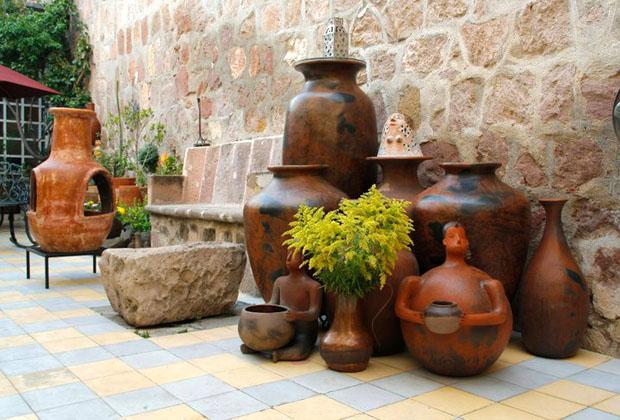 La Casona Rosa Morelia Michoacan Patio with Chimena & Pottery